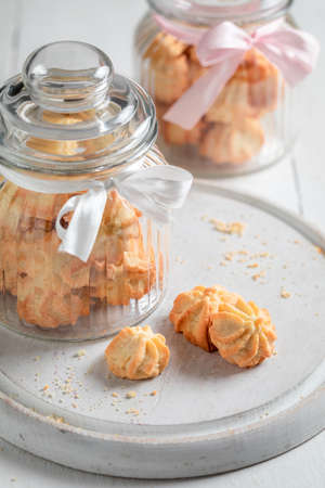 Homemade butter cookies as crunchy and vanilla snack on white table