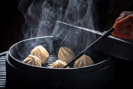 Yummy chinese dumplings in wooden steamer. Old Chinese cuisine.