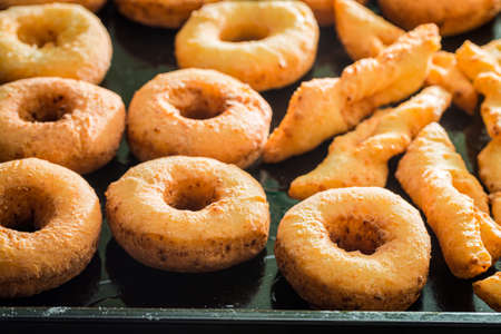 Sweet and hot golden donuts. Homemade pastries. Donuts for Fat Thursday.