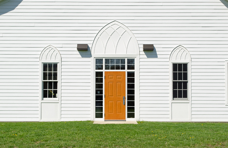 Entrance door with window on white wall