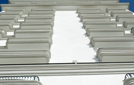 Vertical angle of a white building. Construction, balconies