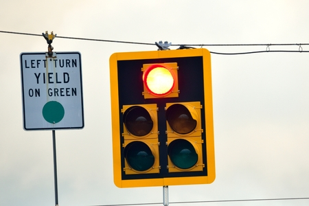 Traffic signal turned red with yield board for green signal