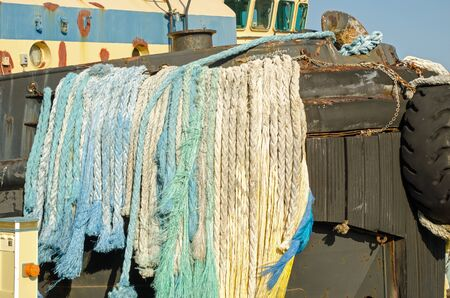 ropes hanging form boat Stock Photo
