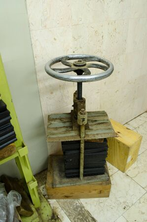an old machine with wheel
