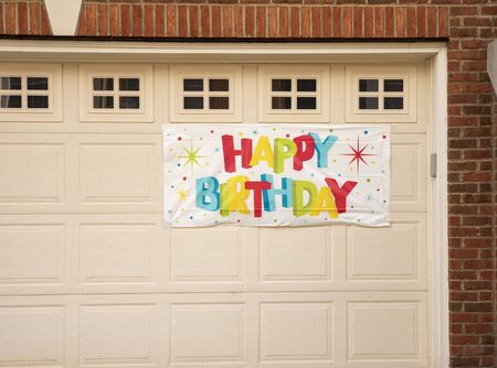 happy Birthday sign on the house Stock Photo