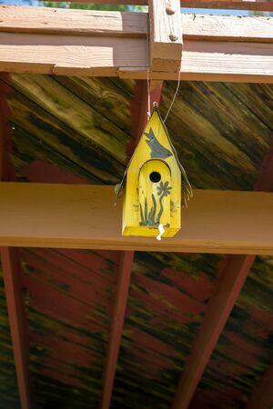 wooden bird feeder house in a garden Archivio Fotografico - 148158030