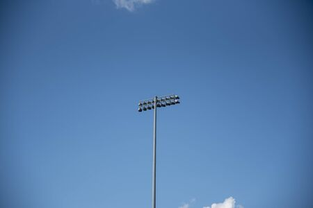 Stadium Lights with blue sky background Archivio Fotografico - 148807735