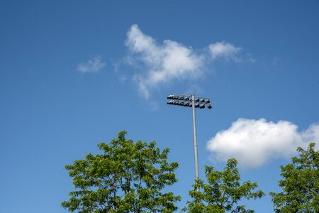 Stadium Lights with blue sky background Stock Photo