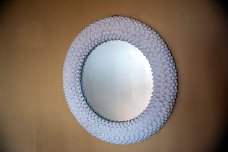 Circular mirror on the wall