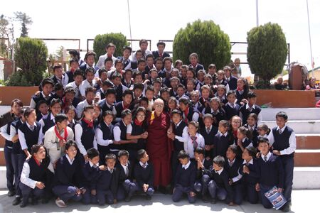 Dalai Lama poses for photographs with school students on the occasion of golden jubilee celebration of Center from School of Tibetan CST at Dalhousie