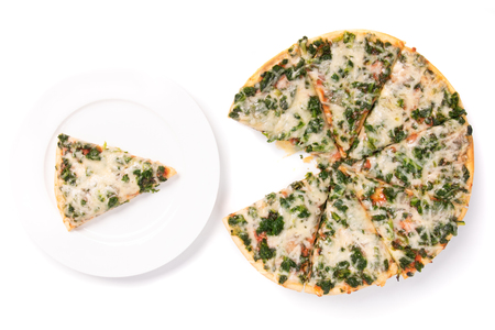 sliced spinach pizza isolated on white, one piece on a plate top view