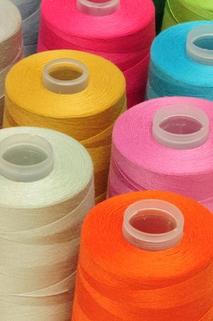 cloth manufacturing: Spool of threads
