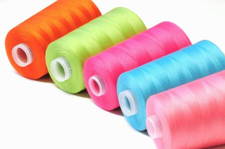 Group of colorful spool of sewing threads photo