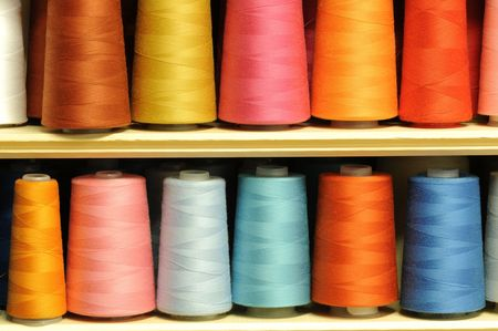 Group of sewing threads in two rows photo