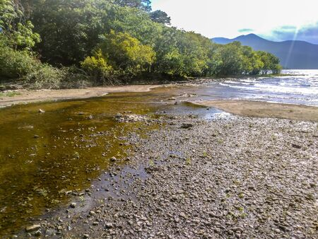 Shallow creekbed flowing into lake Killarney