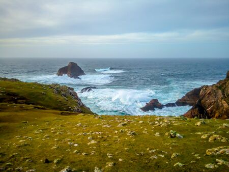 Breakers and Cliffs on the Irish Coast Stock Photo