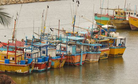Sri Lankan traditional fishing catamarans, Colorful fishing boats docked docked in the port of Beruwala, Sri Lanka.Srilankan traditional fishing industry. similar to india and asia.