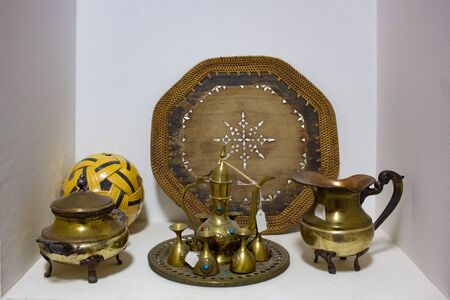 Arab traditional old antique items. Brass coffee pot,cups,plates and trays.
