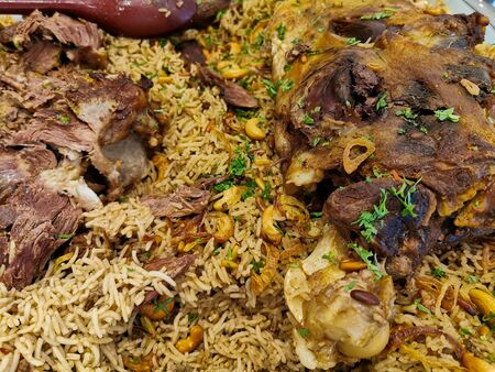 arabic ouzi lamb rice.A kind of traditional arabian rice served with lamb shank. Stuffed lamb with rice