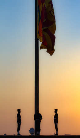 Colombo, Srilanka- 11 December 2019: Srilankan soldiers raising national flag in the Galle face beach