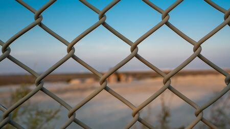 Background image of a garden chain link fence fence