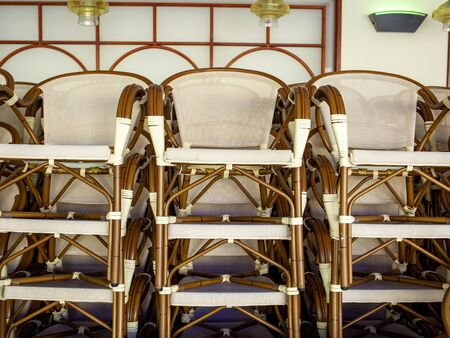 Stack of chairs in a restaurant during coronavirus lock down