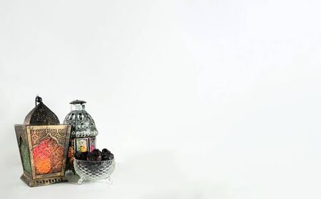 Background image with white background with arabic lantern, dates and beads. Ramadhan and Eid concept