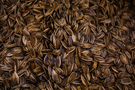 background image of multiple sunflower seeds on the shop