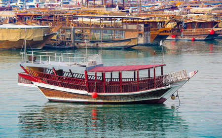Colorful dhows or boats in Doha Qatar. Qatar tourism Stock fotó - 150607485