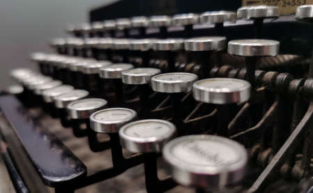 Close up of vintage typewriter keys with selective focus.