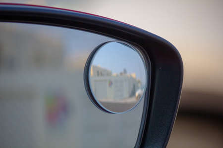 Close up of right blind spot car side mirror