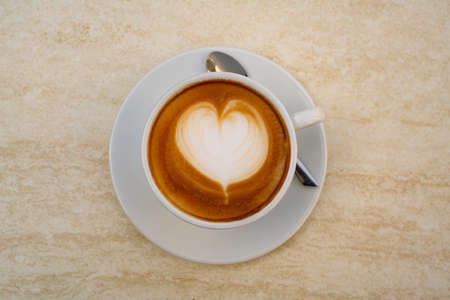 Background image of cappuccino in a cup with coffee beans beans