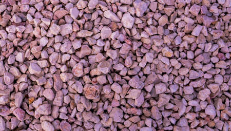 Stone background. blue gravel. Granite texture. The rocky road. Fine pebbles. Construction material. The texture of the stones. Wallpaper with fine gravel.