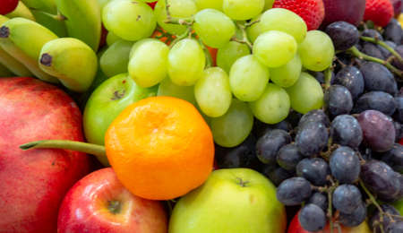 background: Mix of Assorted Fresh fruits at a shop for sale