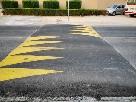Street speed bump in the road for safety painted with yellow color Stockfoto