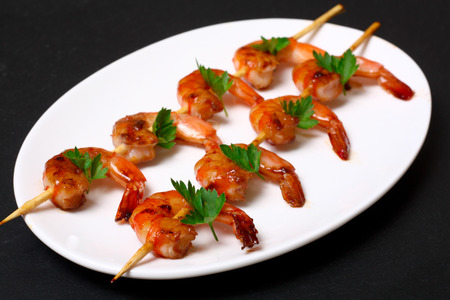 fried shrimp: shrimps on the skewers Stock Photo