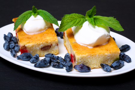 appetizing: Appetizing cottage cheese casserole with berries and sour cream Stock Photo