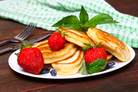 freshly prepared: Plate of delicious freshly prepared pancakes with strawberry
