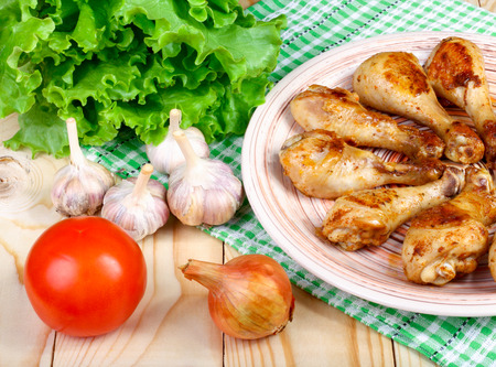 food state: lunch fried chicken legs and vegetables on a wooden table Stock Photo