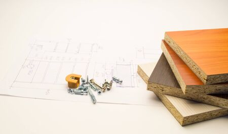 Furniture details and elements lie on a white sheet with product drawings.