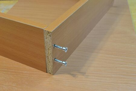 Fastening furniture hinges to the door and the hole for them