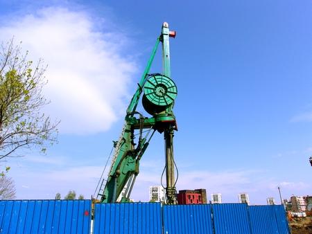 Driller Machine, probe, behind a steel fence