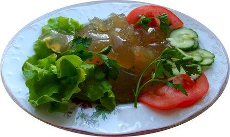 Jelly Mushroom Soup, decorated with leaves of green salad, tomatoe slices and cucumber closeup,studio shot Banco de Imagens