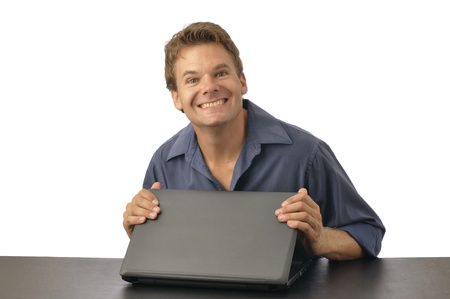 Man with guilty grin closes laptop computer photo