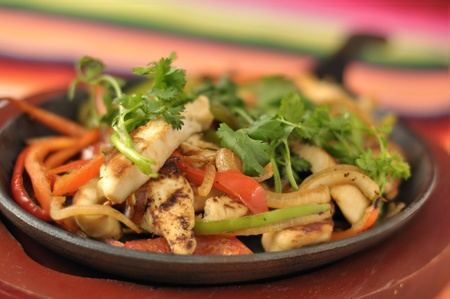 Hot skillet of chicken fajitas and vegetables photo