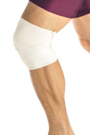 leg calf injury: Leg of male athlete with bandaged knee as he runs