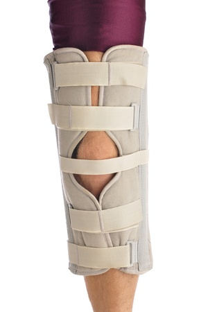 throb: Left leg of male athlete in leg brace Stock Photo
