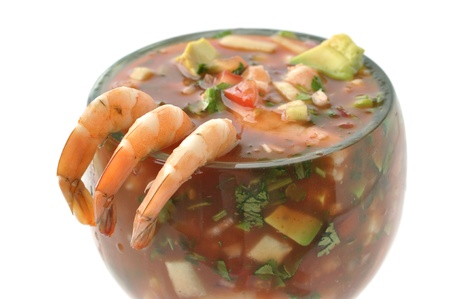 latin food: Closeup of three shrimp on edge of cocktail glass on white background