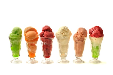 heaping: Six tall glasses of naturally flavored ice creams isolated on white background