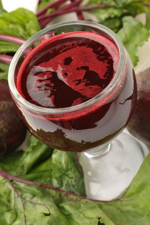 Glass of beet juice and fresh beets